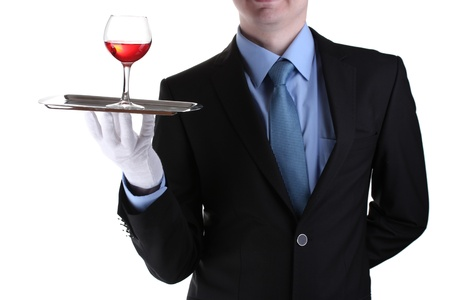 formal waiter with a glass of wine on silver tray isolated on white Stock Photo - 14746951