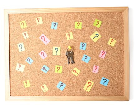 Keys with many question marks on cork board Stock Photo - 14746658