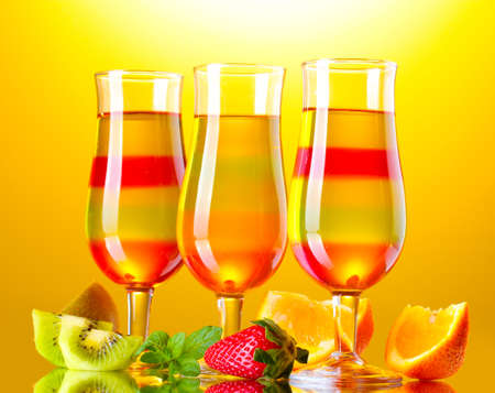 fruit jelly in glasses and fruits on yellow background Stock Photo - 14741455