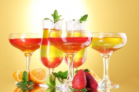 fruit jelly in glasses and fruits on yellow background Stock Photo - 14745062