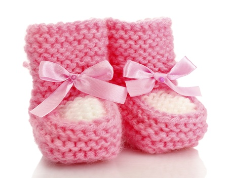 newborn baby girl: pink baby boots isolated on white