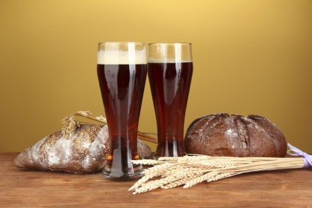 two glasses of kvass with bread on brown background close-up photo