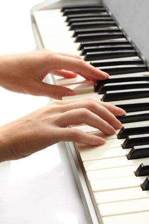 hands of woman playing synthesizer photo