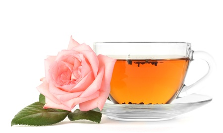 cup of tea with rose isolated on white photo