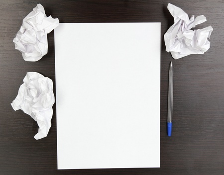 empty paper, crumpled paper and pen on wooden table Stock Photo - 14795157