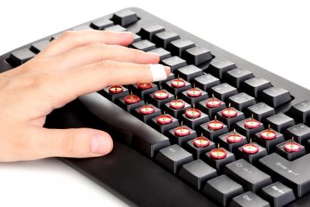 Painful typing on keyboard close-up photo