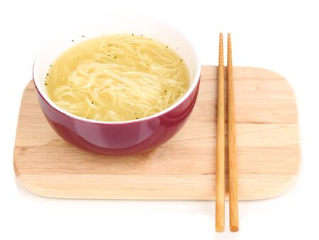 asian noodles in bowl on wooden board isolated on white photo