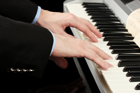man hands playing piano Stock Photo - 14794490