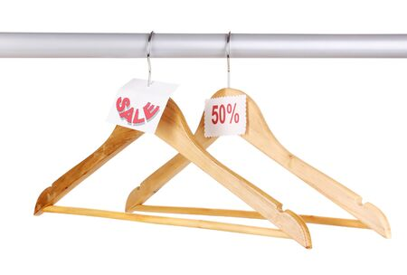 wooden clothes hangers as sale symbol isolated on white Stock Photo - 14775893
