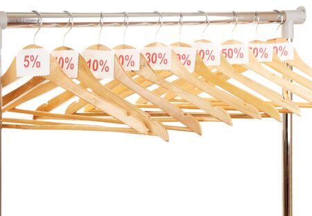 wooden clothes hangers as sale symbol isolated on white  photo