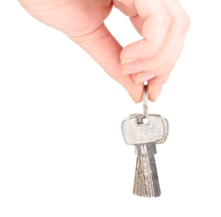Keys in hand isolated on white photo