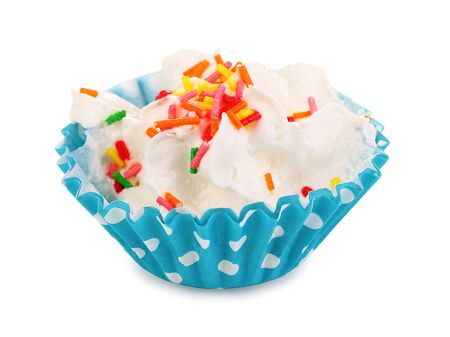 Creamy cupcake isolated on white photo