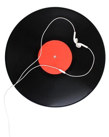 Black vinyl record and headphones isolated on white photo