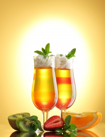 fruit jelly in glasses and fruits on yellow background Stock Photo - 14793881