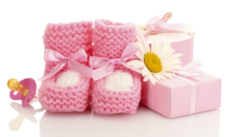pink baby boots, pacifier, gift and flower isolated on white Stock Photo - 14837923