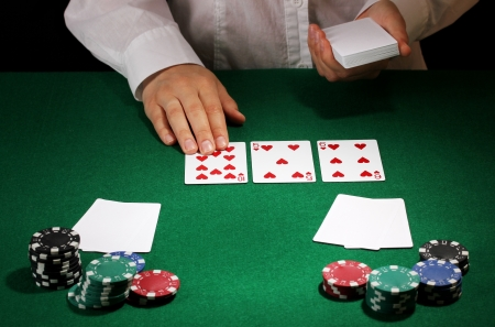 Poker setting on green table photo