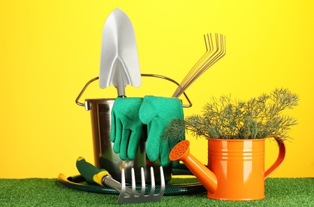 garden tools on lawn on bright colorful background close-up photo