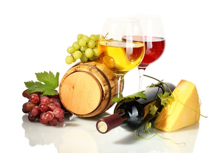barrel, bottle and glasses of wine, cheese and ripe grapes isolated on white photo