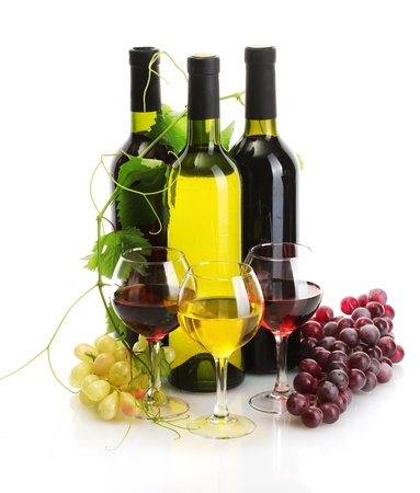 bottles and glasses of wine and ripe grapes isolated on white photo