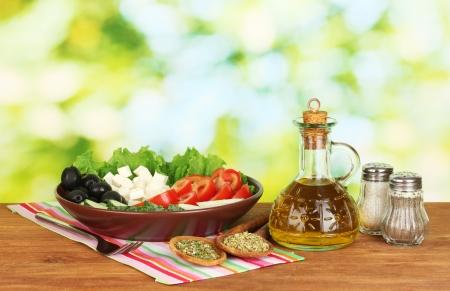 tasty greek salad on bright green background photo