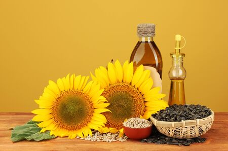 sunflowerseed: sunflower oil and sunflower on yellow background