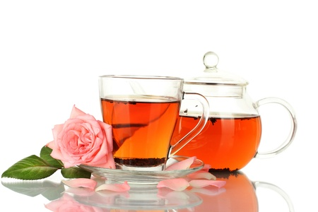 teapot and cup of tea with rose isolated on white photo