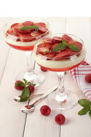 gelatine: fruit jelly with berries in glasses on wooden table
