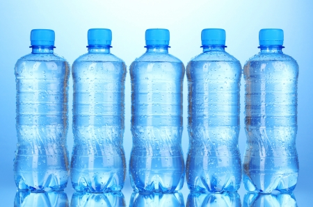 soda bottle: plastic bottles of water on blue background