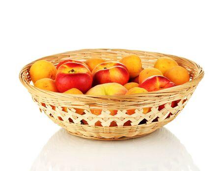 Ripe fruit in basket isolated on white photo