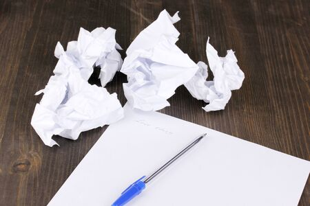 Creation of composition and crumpled sheets on wooden table Stock Photo - 14854452