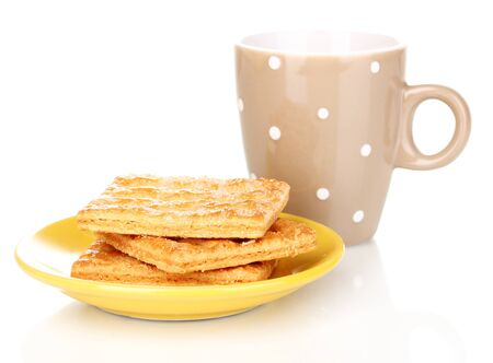 Cup of tea and cookies isolated on white photo