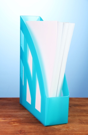 secretary tray: Blue tray for papers on blue background close-up