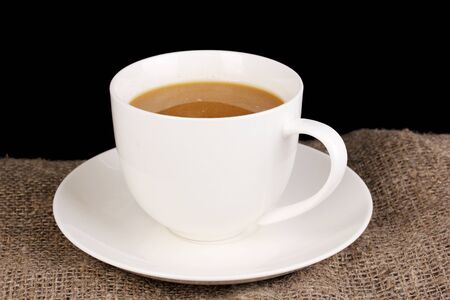 invigorate: Cup of coffee on sacking on brown background