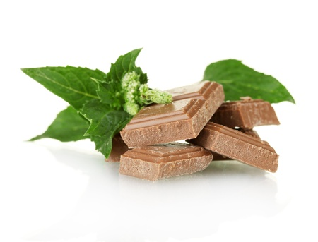 Pieces of chocolate and mint isolated on white photo