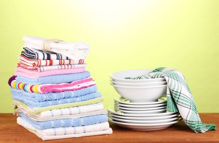 kitchen towels with dishes on green background close-up photo