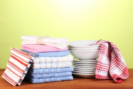 dishtowel: kitchen towels with dishes on green background close-up