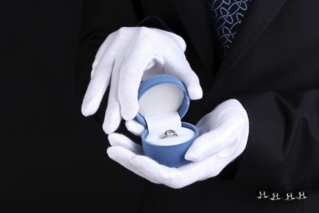 Man's hands holding ring in box Stock Photo - 15195375
