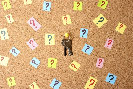 Keys with many question marks on cork board Stock Photo - 15195664