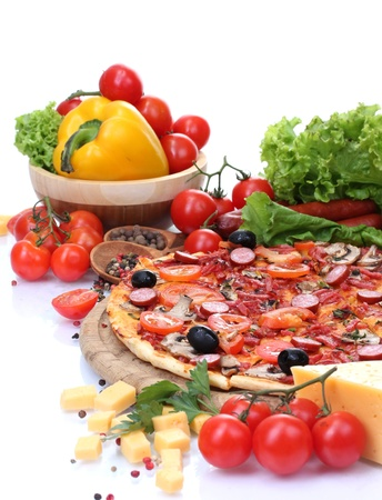 delicious pizza, vegetables and salami isolated on white  photo