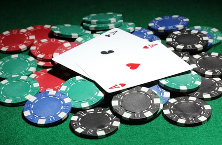 texas hold'em: Cards and chips for poker on green table