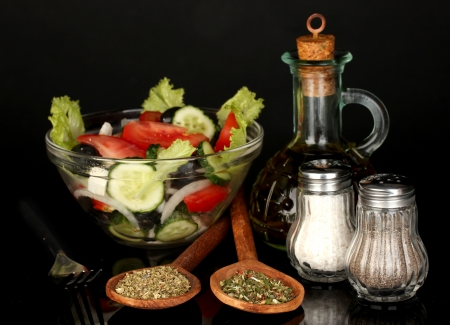 tasty greek salad isolated on black photo