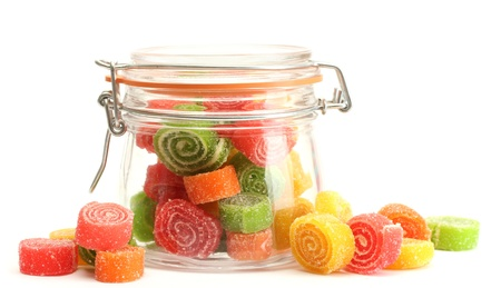 colorful jelly candies in glass jar isolated on white  photo