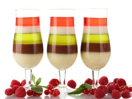 fruit jelly in glasses and raspberries isolated on white photo