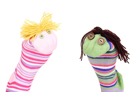Cute sock puppets isolated on white photo