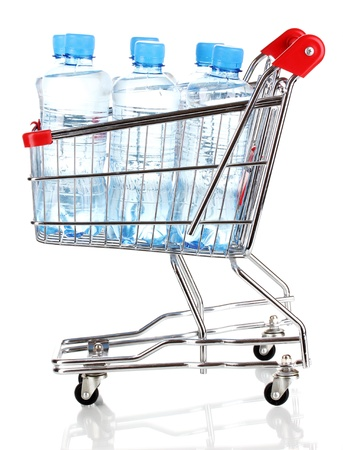 plastic bottles of water in trolley isolated on white photo