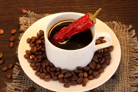 Café para todos...... - Página 2 14918752-coffee-and-pepper-on-wooden-table-on-brown-background