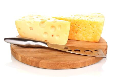 tasty cheese and knife on wooden board isolated on white photo