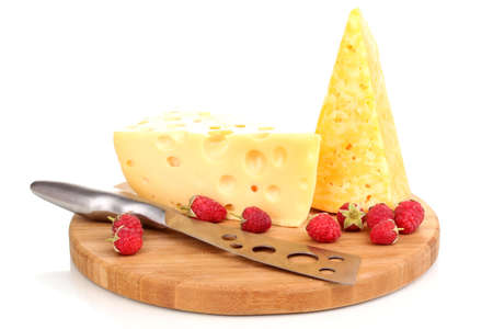 tasty cheese and berries on wooden board isolated on white photo