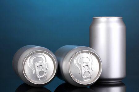 aluminum cans on blue background photo