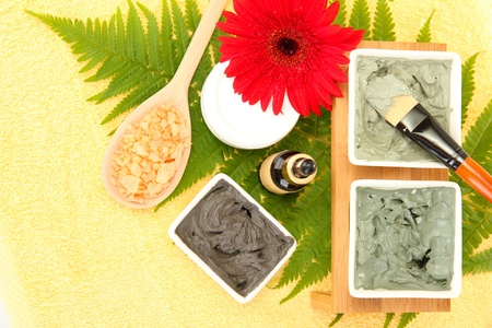 cosmetic clay for spa treatments on yellow background close-up photo